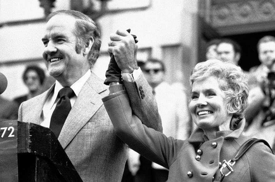 In this Oct. 31, 1972 file photo, Sen. George McGovern holds up the hand of his wife Eleanor and announced to the crowd gathered in downtown Syracuse that today is their 29th wedding anniversary. A family spokesman says, McGovern, the Democrat who lost to President Richard Nixon in 1972 in a historic landslide, has died at the age of 90. According to the spokesman,  McGovern died Sunday, Oct. 21, 2012 at a hospice in Sioux Falls, surrounded by family and friends. (AP Photo/Bob Schutz)