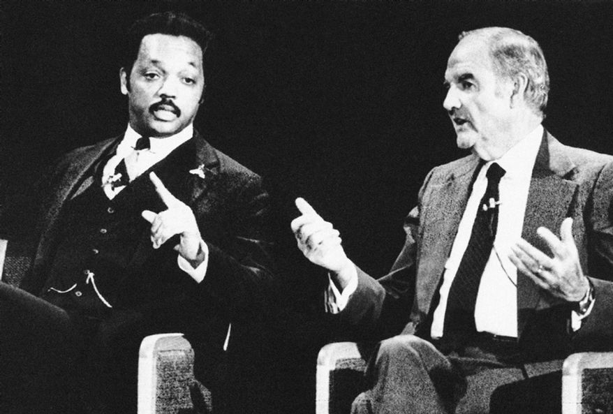In this Feb. 23, 1984 file photo, Rev. Jesse Jackson, left, and former Sen. George McGovern both gesture during the Democratic presidential debate in Manchester, N.H.  A family spokesman says, McGovern, the Democrat who lost to President Richard Nixon in 1972 in a historic landslide, has died at the age of 90. According to the spokesman,  McGovern died Sunday, Oct. 21, 2012 at a hospice in Sioux Falls, surrounded by family and friends.(AP Photo, File)