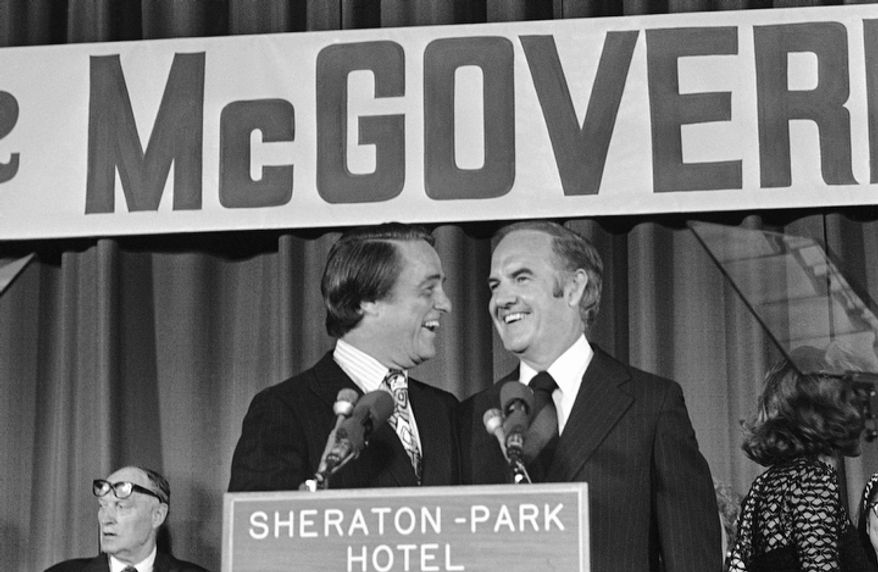 In this Aug. 8, 1972 file photo, Sen. George McGovern and Sargent Shriver in Washington after the Democratic National Committee endorsed Sargent Shriver as the new vice presidential nominee.  A family spokesman says, McGovern, the Democrat who lost to President Richard Nixon in 1972 in a historic landslide, has died at the age of 90. According to the spokesman,  McGovern died Sunday, Oct. 21, 2012 at a hospice in Sioux Falls, surrounded by family and friends. (AP Photo, File)