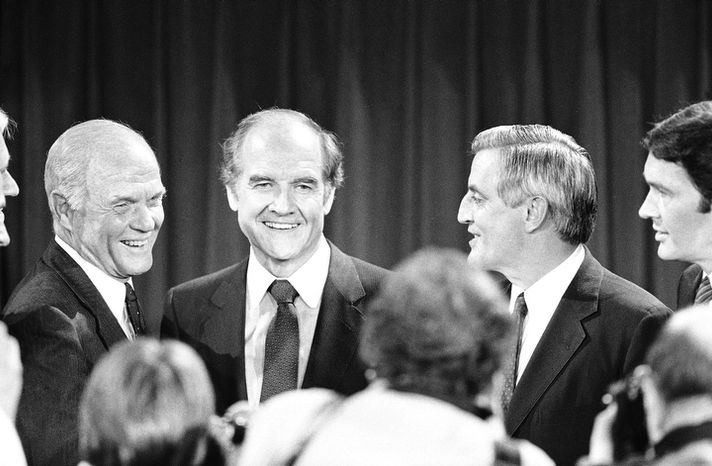 In this Oct. 13, 1983 file photo, Presidential hopefuls, Sen. John Glenn, left, former Sen. George McGovern, center, and former Vice-President Walter Mondale, right, pause for photographers after debating the nuclear arms issue at the Kennedy School of Government at Harvard University in Cambridge, Mass.  A family spokesman says, McGovern, the Democrat who lost to President Richard Nixon in 1972 in a historic landslide, has died at the age of 90. (AP Photo/Elise Amendola, File)