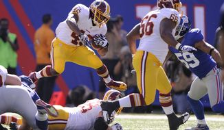 Washington Redskins running back Alfred Morris (46) leaps over the line during a first-quarter carry against the New York Giants at MetLife Stadium in East Rutherford, N.J., on Sunday, Oct. 21, 2012. (Preston Keres/Special to The Washington Times)