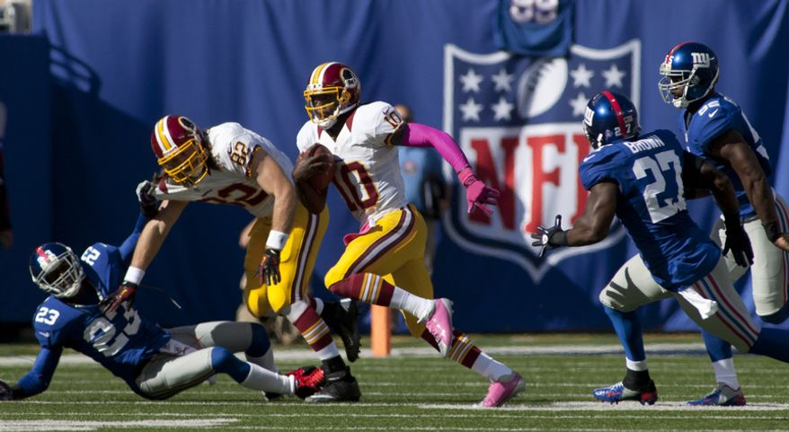 Washington Redskins quarterback Robert Griffin III (10) makes a run against the New York Giants at Metlife Stadium, East Rutherford, N.J., Oct. 21, 2012 (Craig Bisacre/The Washington Times)