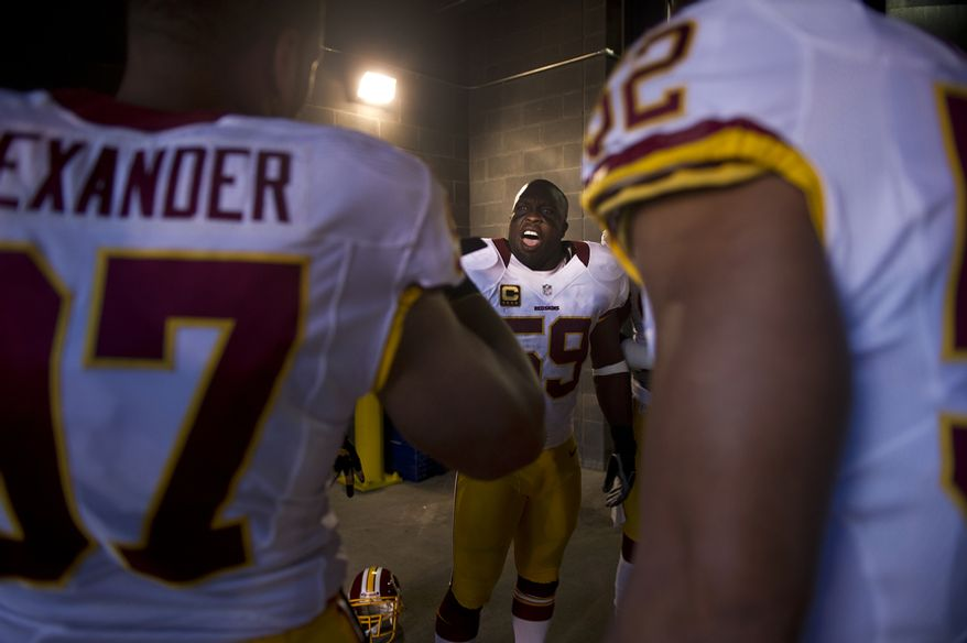 Washington Redskins inside linebacker London Fletcher (59) pumps up his teammates in the tunnel before taking on the New York Giants at MetLife Stadium, East Rutherford, N.J., Oct. 21, 2012. (Preston Keres/Special to The Washington Times)
