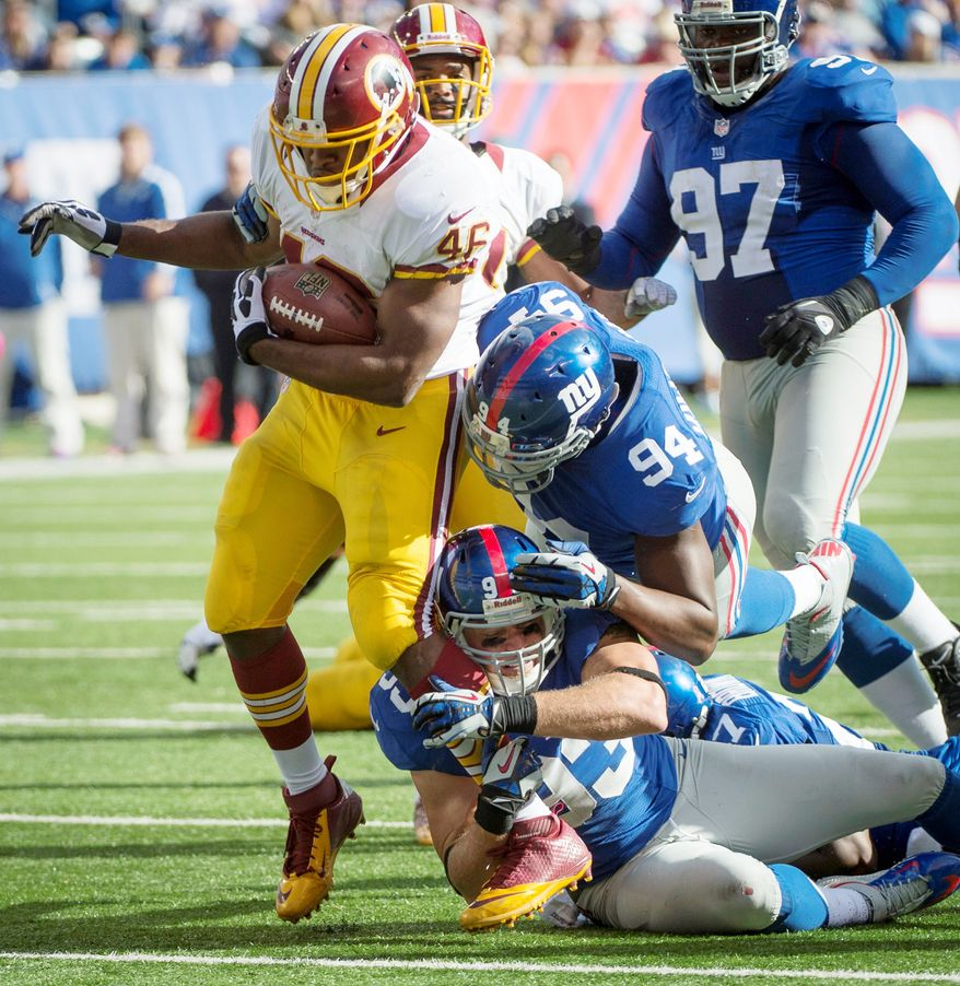 Washington Redskins running back Alfred Morris (46) is brought down third quarter at MetLife Stadium in East Rutherford, N.J., Sunday, Oct. 21, 2012. (Rod Lamkey Jr./The Washington Times)