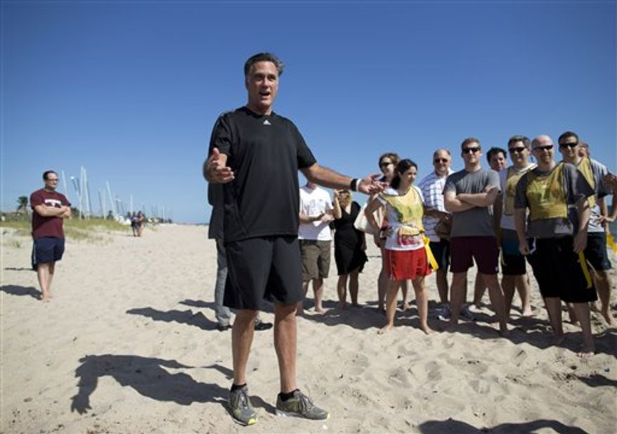 Republican presidential candidate Mitt Romney speaks before the start of a flag football game between his staff and reporters covering his campaign on Oct. 21, 2012 in Delray Beach, Fla. Romney took a short break from debate preparations to do the opening coin toss, and watch the first play of the game. (Associated Press)
