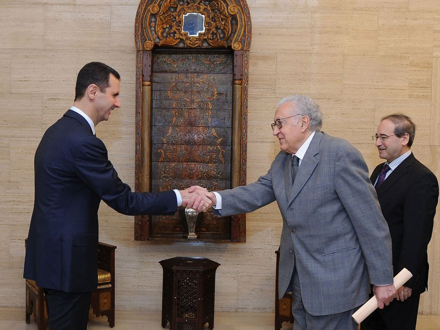 ** FILE ** Syrian President Bashar Assad (left) greets U.N. and Arab League envoy Lakhdar Brahimi before their closed-door meeting in Damascus, Syria, on Sunday, Oct. 21, 2012. (AP Photo/SANA)