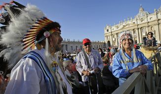 North American Indians in headdresses await the start of a canonization ceremony celebrated by Pope Benedict XVI in St. Peter's Square at the Vatican on Sunday, Oct. 21, 2012. Those people elevated to sainthood included Kateri Tekakwitha, the first American Indian saint, and Mother Marianne Cope, who nursed lepers in Hawaii. (AP Photo/Andrew Medichini)