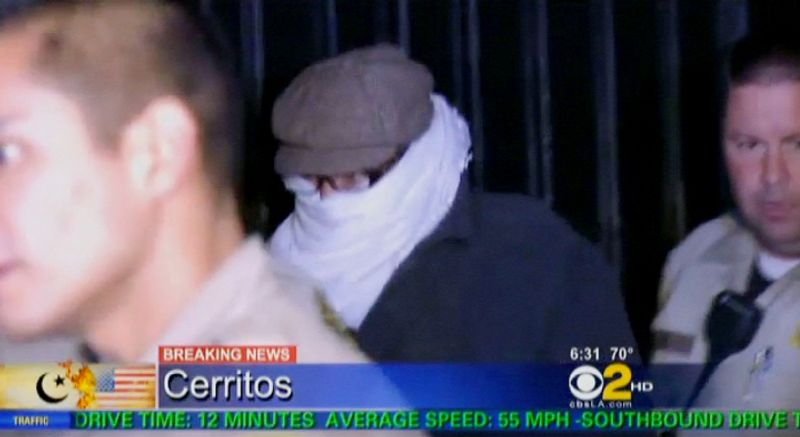 ** FILE ** Nakoula Basseley Nakoula, the man behind the anti-Muslim movie that inflamed the Middle East, is escorted by Los Angeles County sheriff's deputies from his home early on Saturday, Sept. 15, 2012, in Cerritos, Calif. (AP Photo/CBS2-KCAL9)