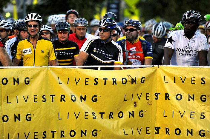 Riders wait at the starting gate at the Livestrong Challenge Austin bike ride on Sunday, Oct. 21, 2012, in Austin, Texas. Lance Armstrong greeted about 4,300 cyclists at his Livestrong charity's fundraiser and then retreated into privacy as cycling officials got set to announce if they will appeal his lifetime ban and loss of seven Tour de France titles ordered by the U.S. Anti-Doping Agency. (AP Photo/Michael Thomas)
