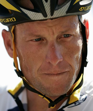 Seven-time Tour de France cycling champion Lance Armstrong of the United States is pictured during a stop on the third day of training with team Astana in Adelaide, Australia, on Jan. 14, 2009. UCI, cycling's governing body, agreed on Monday, Oct. 22, 2012, to strip Armstrong of his seven Tour de France titles. (AP Photo/Aman Sharma, file)
