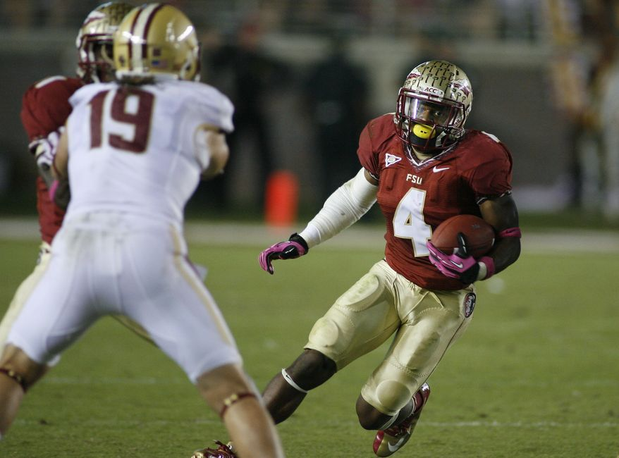 Florida State running back Chris Thompson (4) gets a block as he runs for a six-yard gain in the third quarter of an NCAA college football game against Boston College on Saturday, Oct. 13, 2012, in Tallahassee, Fla. Florida State won 51-7. (AP Photo/Phil Sears)
