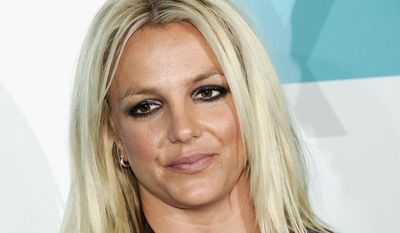 """** FILE ** Singer and """"X Factor"""" judge Britney Spears attends the Fox network upfront presentation party at Wollman Rink in New York on Monday, May 14, 2012. (Associated Press)"""