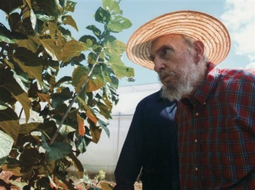 This picture released by Cubadebate on its website early Monday, Oct. 22, 2012, shows Cuban leader Fidel Castro in Havana, Cuba, on Sunday, Oct. 21, 2012. Castro has written an article on Sunday in state-media criticizing those who spread rumors he was on his death bed. (AP Photo/Alex Castro, Cubadebate)