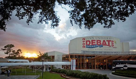 The sun sets ahead of the presidential debate between Republican presidential candidate, former Massachusetts Gov. Mitt Romney and President Barack Obama, at Lynn University, Monday, Oct. 22, 2012, in Boca Raton, Fla. (AP Photo/David Goldman)