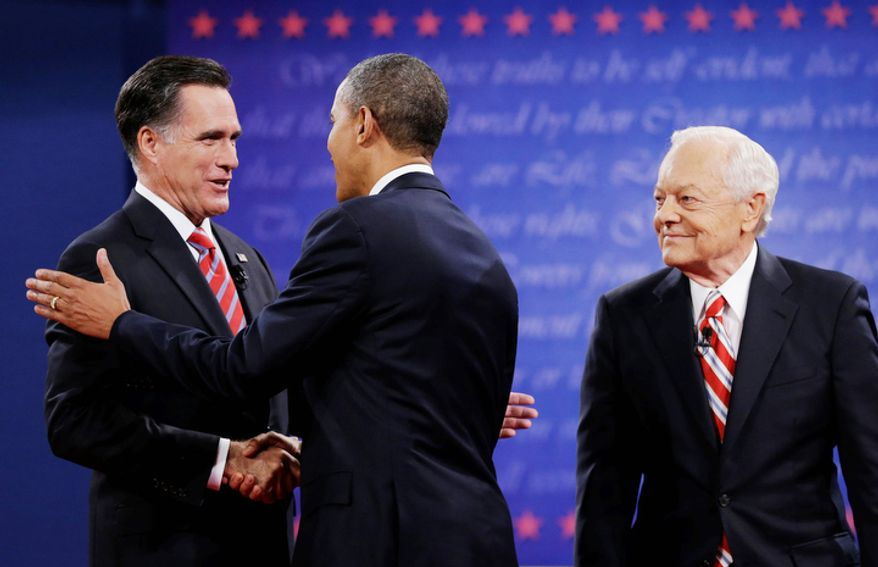 Moderator Bob Schieffer, right, watches as President Barack Obama, center, shakes hands with Republican presidential nominee Mitt Romney during the third presidential debate at Lynn University. (AP Photo/Eric Gay)