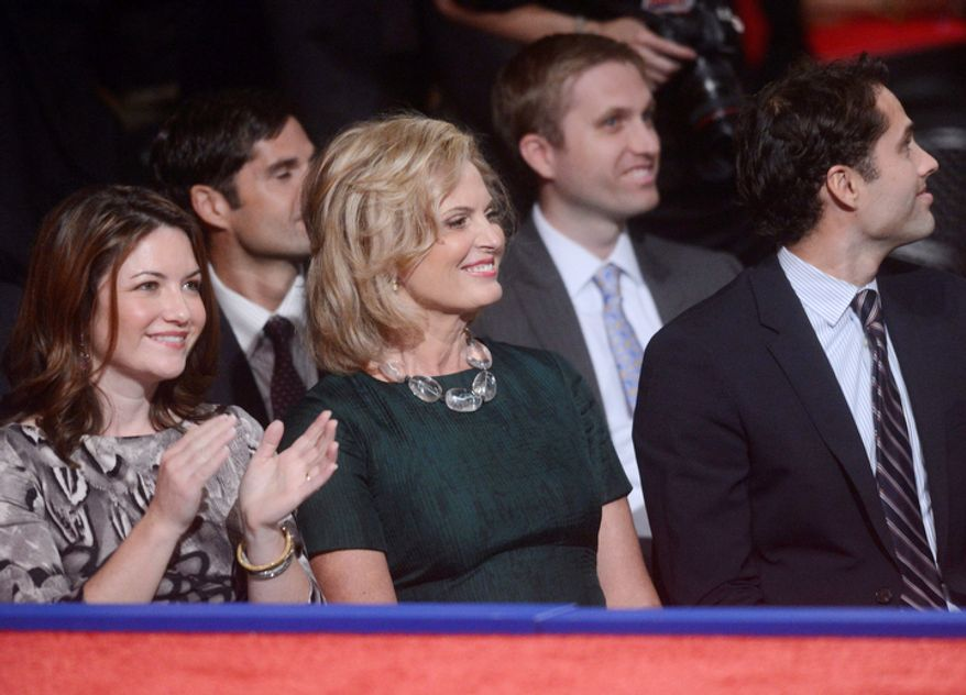 Ann Romney, center, wife of Republican presidential nominee Mitt Romney, watches activity before the start of the third presidential debate at Lynn University. (AP Photo/Pool-Michael Reynolds)