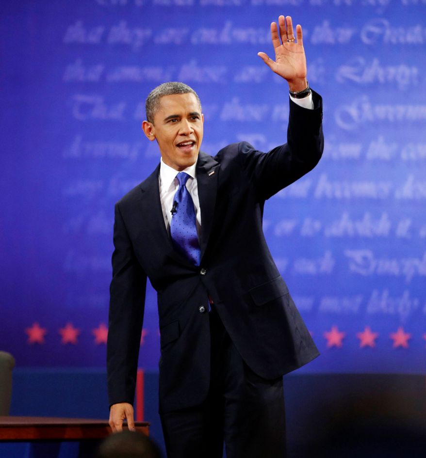 President Barack Obama, right, waves to members of the audience before the start of the last debate. (AP Photo/Pablo Martinez Monsivais)