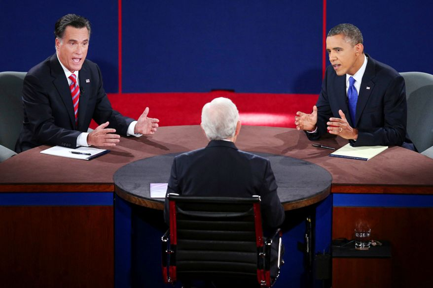 Republican presidential nominee Mitt Romney and President Barack Obama answer a question during the third presidential debate at Lynn University. (AP Photo/Pool-Win McNamee)