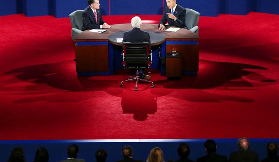 President Barack Obama answers a question as Republican presidential nominee Mitt Romney listens during the third presidential debate. (AP Photo/Pool, Win McNamee)