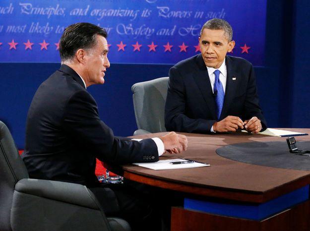 President Barack Obama listens as Republican presidential nominee Mitt Romney speaks during the third presidential debate at Lynn University. (AP Photo/Pool-Rick Wilking)