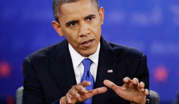President Barack Obama speaks during the third presidential debate with Republican presidential nominee Mitt Romney. (AP Photo/David Goldman)