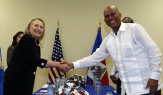 Secretary of State Hillary Rodham Clinton meets with Haitian President Michel Martelly at the Sae-A administration building at the Caracol Industrial Park in Caracol, Haiti, on Monday, Oct. 22, 2012. (AP Photo/Larry Downing, Pool)