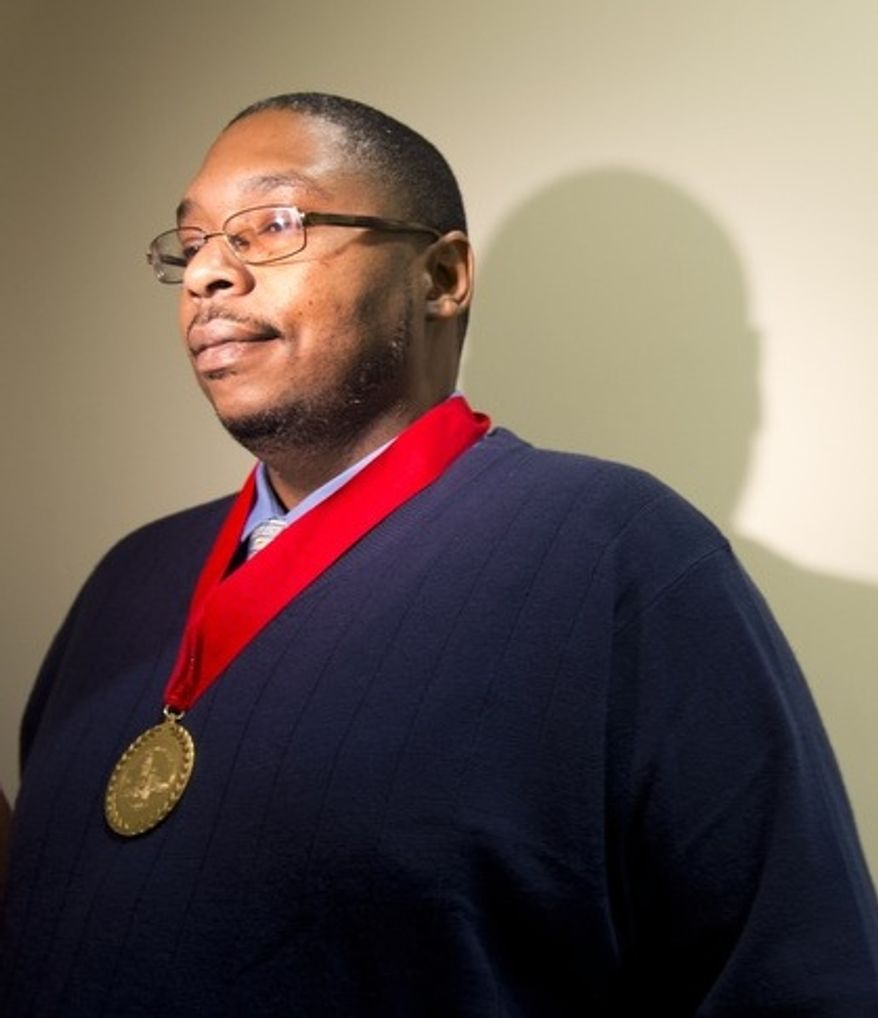 Leonard Johnson, building manager for the Family Research Council who was shot on Aug. 15 when a gunman entered the lobby of the FRC building, was awarded a Medal of Honor by Mayor Vincent Gray on Monday, Oct. 22, 2012. The ceremony was closed to the media. Mr. Johnson was the first recipient of the Mayor's Medal of Honor and is credited with saving many lives. (Barbara L. Salisbury/The Washington Times)