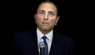 "NHL Commissioner Gary Bettman faces journalists following collective bargaining talks in Toronto, Thursday, Oct. 18, 2012. Bettman received three counterproposals from the players' association on Thursday and left the negotiating table ""thoroughly disappointed,"" further shrinking the possibility of a full hockey regular season. (AP Photo/The Canadian Press, Chris Young)"