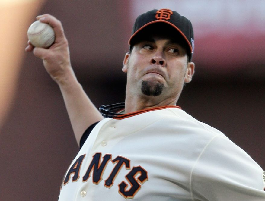 San Francisco Giants starting pitcher Ryan Vogelsong throws during the first inning of Game 6 of the National League Championship Series against the St. Louis Cardinals on Oct. 21, 2012, in San Francisco. The Giants won 6-1 to force a decisive Game 7. (Associated Press)