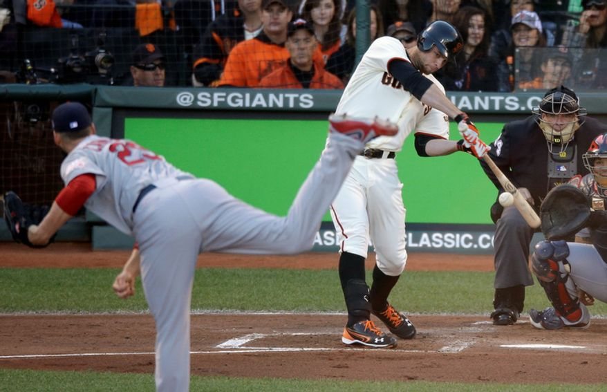 San Francisco Giants 1B Brandon Belt hits a triple off of St. Louis Cardinals pitcher Chris Carpenter during the second inning of Game 6 of the National League Championship Series on Oct. 21, 2012, in San Francisco. The Giants won 6-1 to force a decisive Game 7. (Associated Press)