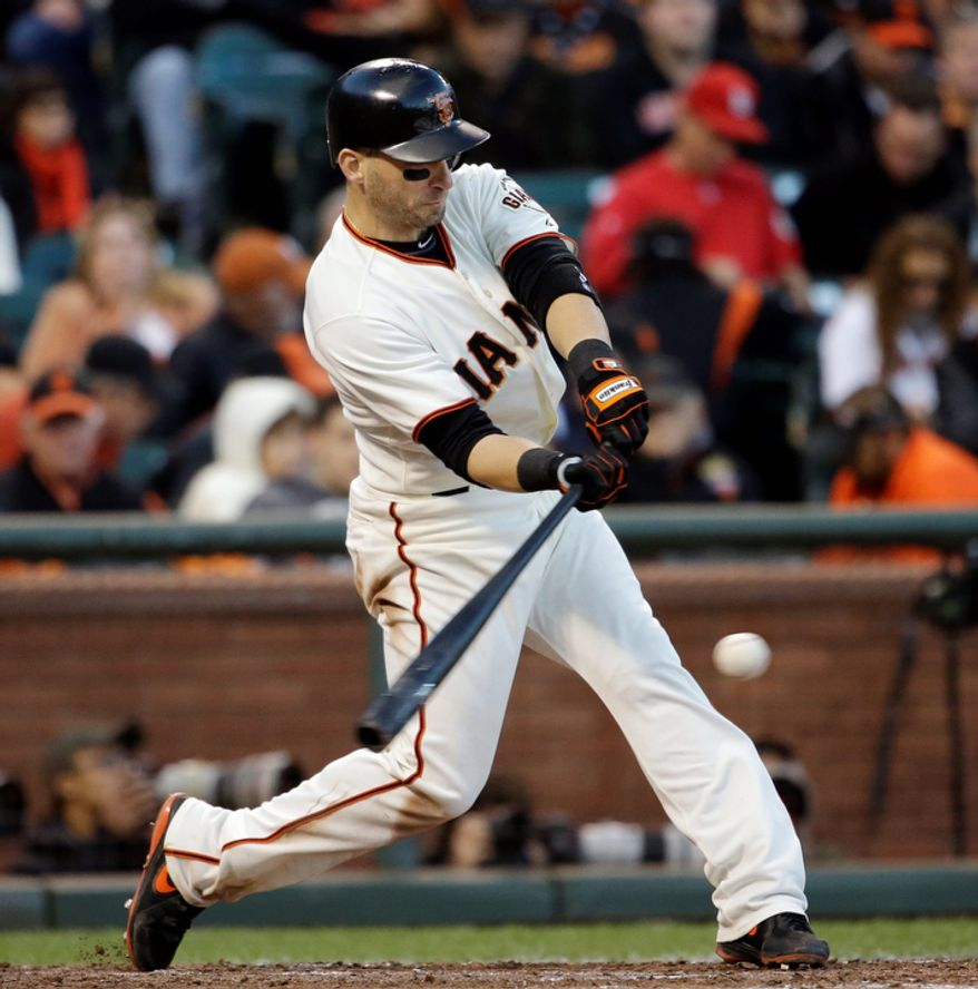 San Francisco Giants 2B Marco Scutaro hits a single during the fourth inning of Game 6 of the National League Championship Series on Oct. 21, 2012, against the St. Louis Cardinals in San Francisco. The Giants won 6-1 to force a decisive Game 7. (Associated Press)