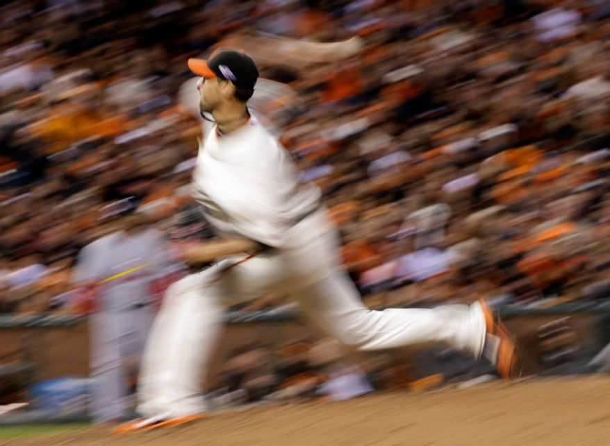 San Francisco Giants starting pitcher Ryan Vogelsong throws during the sixth inning of Game 6 of the National League Championship Series against the St. Louis Cardinals on Oct. 21, 2012, in San Francisco. The Giants won 6-1 to force a decisive Game 7. (Associated Press)