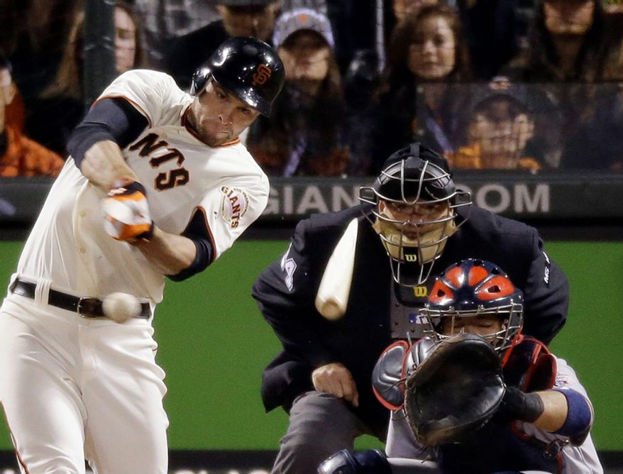 San Francisco Giants 1B Brandon Belt breaks his bat as he hits a single against the St. Louis Cardinals during the eighth inning of Game 6 of the National League Championship Series on Oct. 21, 2012, in San Francisco. The Giants won 6-1 to force a decisive Game 7. (Associated Press)