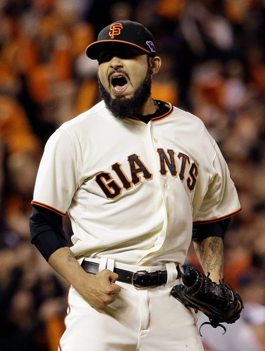 San Francisco Giants pitcher Sergio Romo reacts after the final out in the ninth inning of Game 6 of the National League Championship Series against the St. Louis Cardinals on Oct. 21, 2012, in San Francisco. The Giants won 6-1 to force a decisive Game 7. (Associated Press)