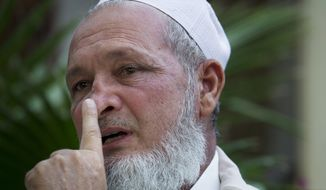 On Wednesday, Oct. 17, 2012, Haji Zahid Khan, a member of a major tribal council in Mingora, Pakistan, in the Swat Valley, shows where a bullet struck his nose in Mingora, Swat Valley, Pakistan. A Taliban gunman shot him as he was heading to a local mosque in August, but he managed to survive, even though the bullet tore through his neck and exited at the front of his face. (AP Photo/B.K. Bangash)