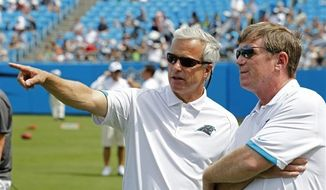 ** FILE ** In this Aug. 4, 2012, file photo, Carolina Panthers' team president Danny Morrison, left, talks with general manager Marty Hurney during the NFL Carolina Panthers' Fan Fest football practice in Charlotte, N.C. The Panthers fired Hurney Monday, Oct. 22, 2012, following the team's 1-5 start this season. (AP Photo/Bob Leverone, File)