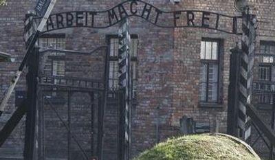 "The entrance with the inscription ""Arbeit Macht Frei"" (Work Sets You Free) gate of the former German Nazi death camp of Auschwitz is seen at the Auschwitz-Birkenau memorial in Oswiecim, Poland, Friday, Oct. 19, 2012. (AP Photo/Czarek Sokolowski)"
