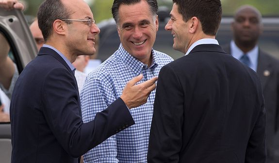 Republican presidential candidate, former Massachusetts Gov. Mitt Romney, center, talks with foreign policy adviser Dan Senor, left, and his vice presidential running mate, Rep. Paul Ryan, R-Wis., before boarding his campaign plane at Daytona International Airport, Saturday, Oct. 20, 2012, in Daytona Beach, Fla.  (AP Photo/ Evan Vucci)