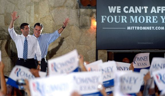 Republican presidential candidate, former Massachusetts Gov. Mitt Romney, right, and his vice presidential running mate Rep. Paul Ryan, R-Wis., wave to supporters as they walk on stage for the Romney Ryan Victory Rally in Daytona Beach, Fla., Friday, Oct. 19, 2012. (AP Photo/Phelan M. Ebenhack)