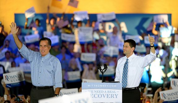Republican presidential candidate, former Massachusetts Gov. Mitt Romney, left, and his vice presidential running mate Rep. Paul Ryan, R-Wis., wave to supporters after arriving on stage during the Romney Ryan Victory Rally in Daytona Beach, Fla., Friday, Oct. 19, 2012. 3(AP Photo/Phelan M. Ebenhack)