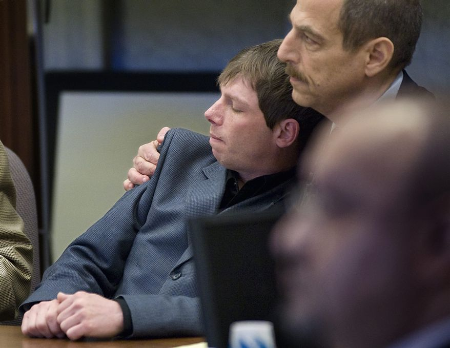 **FILE** Kerry Lewis (left) leans into his lawyer, Paul Mones, in a Portland, Ore., courtroom on April 13, 2010, after a jury found the Boy Scouts of America negligent for repeated sexual abuse of Lewis by an assistant Scoutmaster in the 1980s. (Associated Press/The Oregonian)