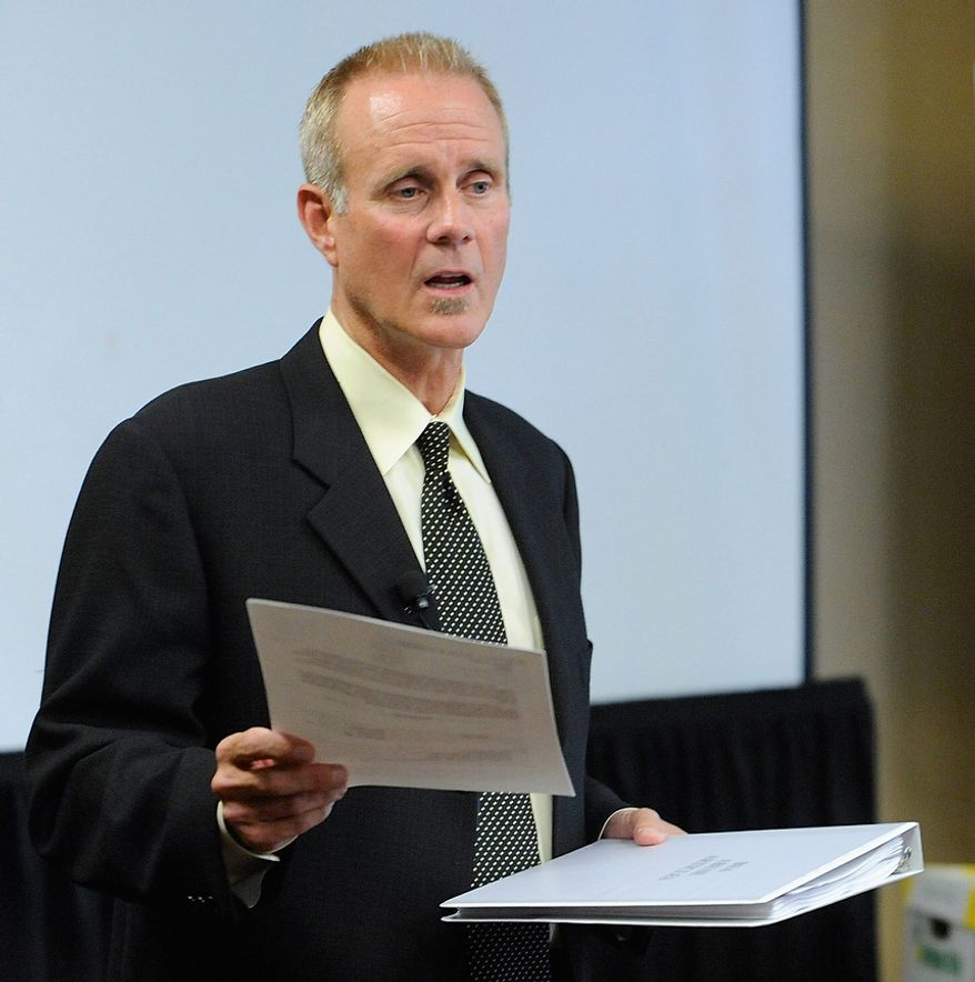 Portland attorney Kelly Clark holds a letter at an Oct., 18, 2012, press conference in Portland, Ore., to the U.S. Congress regarding some of the 14,500 pages of previously confidential documents created by the Boy Scouts of America concerning child sexual abuse within the organization. The documents were publicly released despite The Boy Scouts' fight to keep those files confidential. (Associated Press)