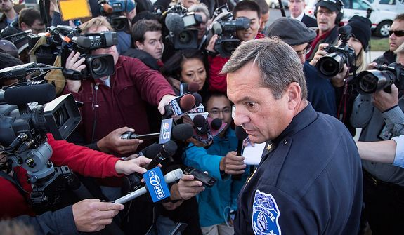 Brookfield Chief of Police Dan Tushaus speaks with reporters in Brookfield, Wis., Sunday , Oct. 21, 2012. The man police suspected of killing three and wounding four by opening fire at a tranquil day spa was found dead following a six-hour manhunt that locked down a shopping center, country club and hospital in suburban Milwaukee. (AP Photo/Tom Lynn)