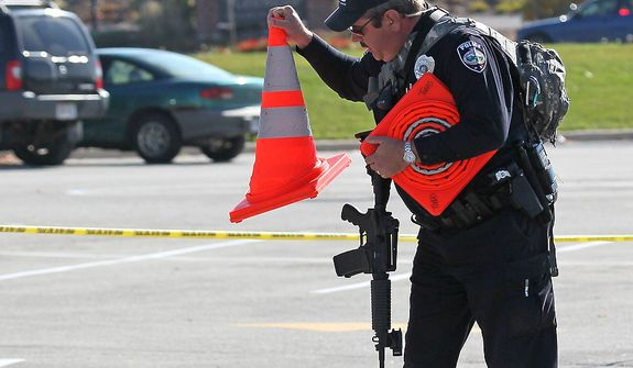 Police block off access to Brookfield Square parking areas in Brookfield, Wis., Sunday, Oct. 21, 2012. Multiple people were wounded when someone opened fire at the spa near the Brookfield Square Mall. Deputies are still looking for the gunman. (AP Photo/Milwaukee Journal-Sentinel, Michael Sears)