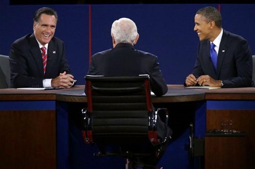 Republican presidential nominee Mitt Romney and President Barack Obama react to moderator Bob Schieffer during the third presidential debate at Lynn University, Monday, Oct. 22, 2012, in Boca Raton, Fla. (AP Photo/Charlie Neibergall)
