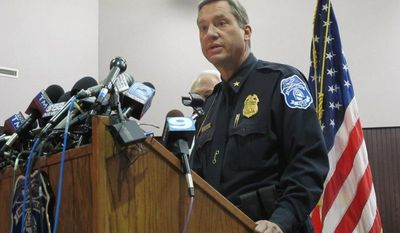 Brookfield Police Chief Dan Tushaus briefs reporters in an evening news conference in Brookfield, Wis., on Oct. 21, 2012, after a man who had been accused of domestic violence and slashing his wife's tires took a gun into the spa where she worked and shot seven women, three fatally, before killing himself. (Associated Press)
