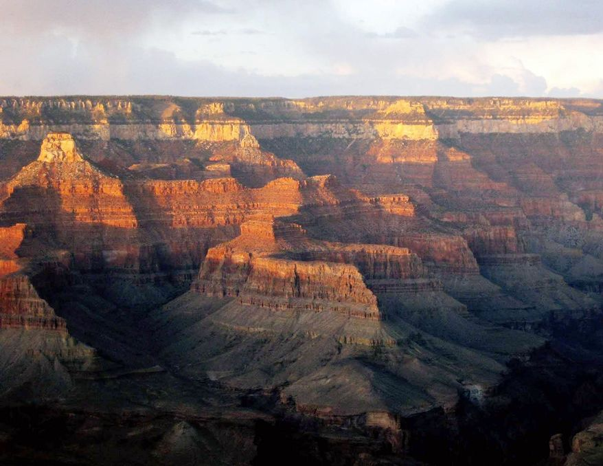 "Pictures that inspire awe can be beneficial in hectic lives. The Grand Canyon, beckoning with the colors of a late-fall sunset, is an example of awe-inspiring nature, which psychologists say causes people to feel their ""experiences are fuller, that more can happen or be accomplished during a period of time,"" Melanie Rudd says. (Associated Press)"