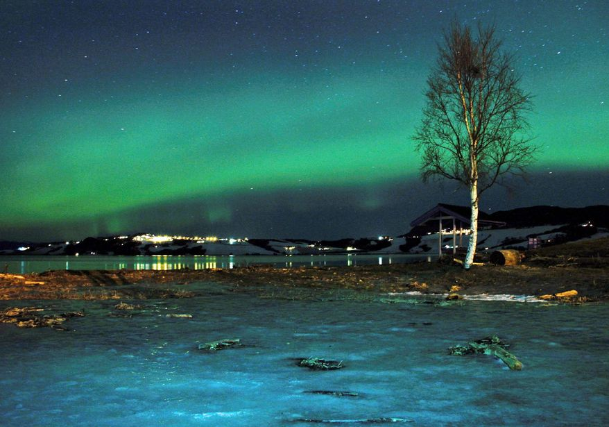 """The northern lights are aglow near Trondheim, Norway. Skygazers turn out in force, hoping to be awed by the spectacular show in the northern latitudes. """"Awe is the most 'spiritual' of the positive emotions,"""" writes a Harvard psychologist. (Associated Press)"""