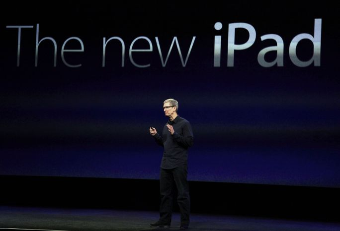 **FILE** Apple CEO Tim Cook announces a new iPad on March 7, 2012, in San Francisco. (Associated Press)