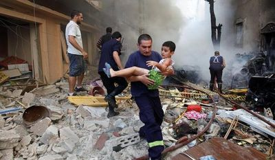 A Lebanese rescuer carries Joseph Naimeh, 6, at the scene of a car bomb attack in the mostly Christian neighborhood of Achrafiyeh in Beirut on Oct. 19, 2012. (Associated Press)